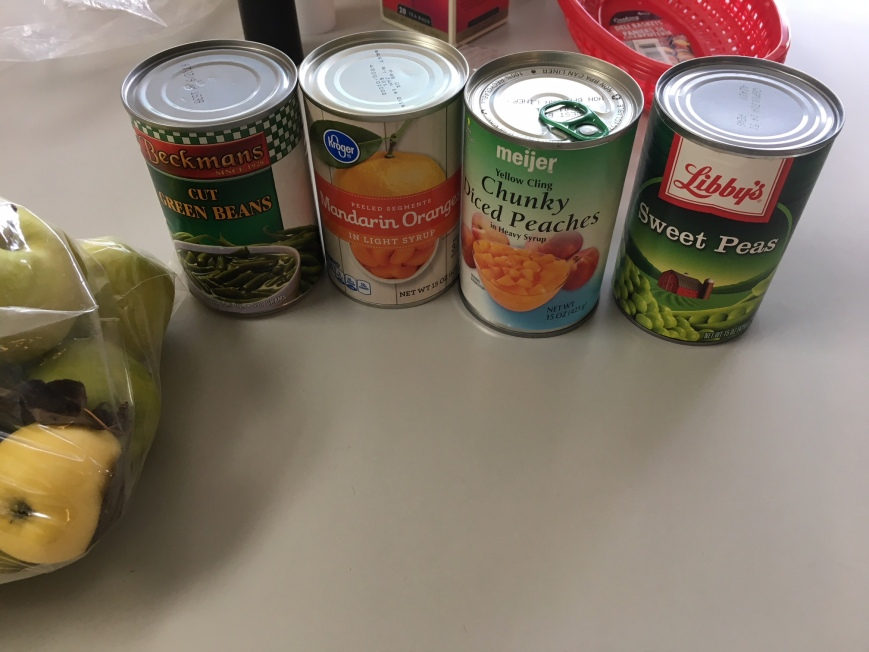 Canned goods: Green beans, mandarins, peaches, and sweet peas