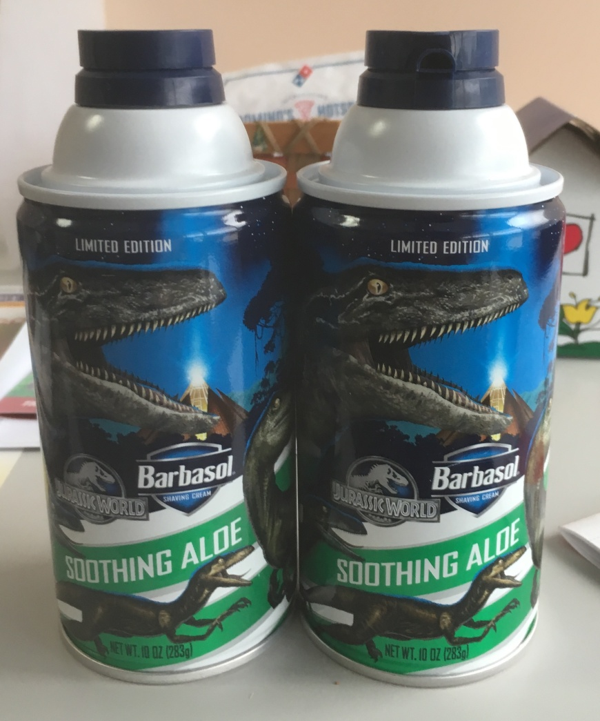 Two cans of Jurassic World-themed shaving cream