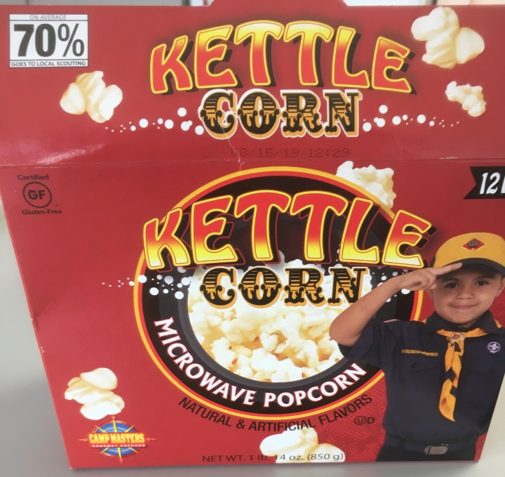 Box of microwave kettle corn with a Cub Scout on the front.
