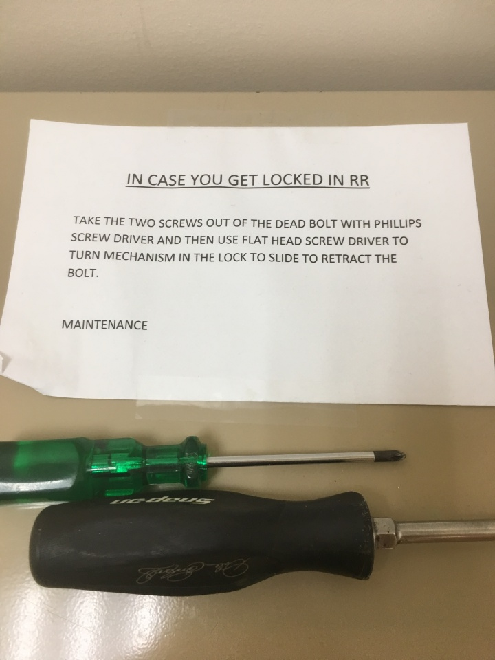 Sign giving instructions for if you're locked in the restroom.