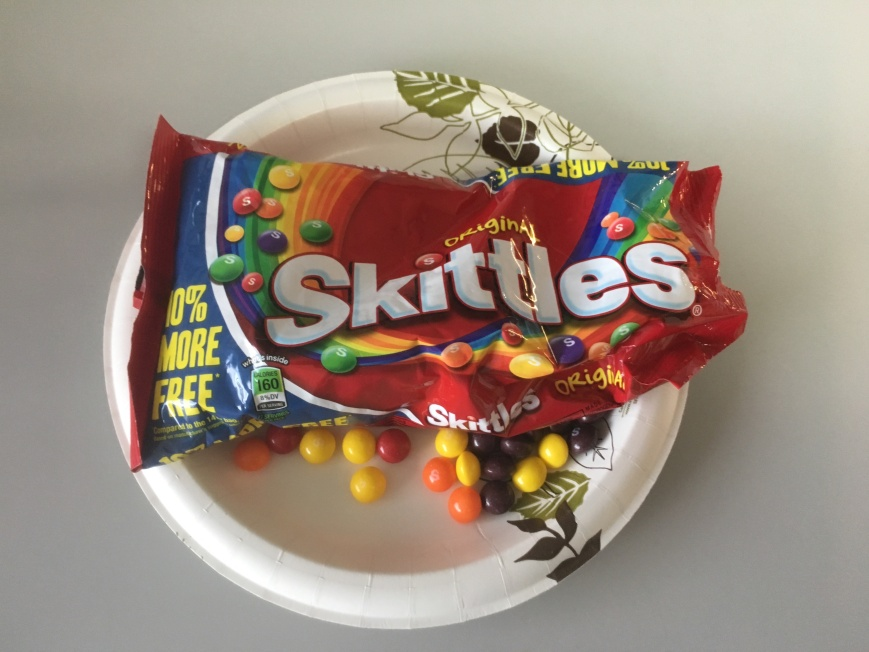 Open bag of skittles, with no visible green ones.